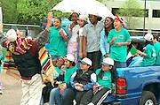 Director warming up children's chorus before Cinco de Mayo parade.  St Paul Minnesota USA