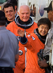 KENNEDY SPACE CENTER-10/29/98-GLENN-Mission specialist John Glenn is sandwiched between payload specialist Chiaki Mukai (front) and mission specialist Pedro Doque (behind) as the crew of STS-95 boards the Astrovan for their ride to launch pad 39-B where they will board the space shuttle Discovery for a scheduled 2 p.m. launch, Thursday. Glenn, the first American to orbit the Earth 36 years ago, is now, at age 77, the oldest person to ever fly in space.