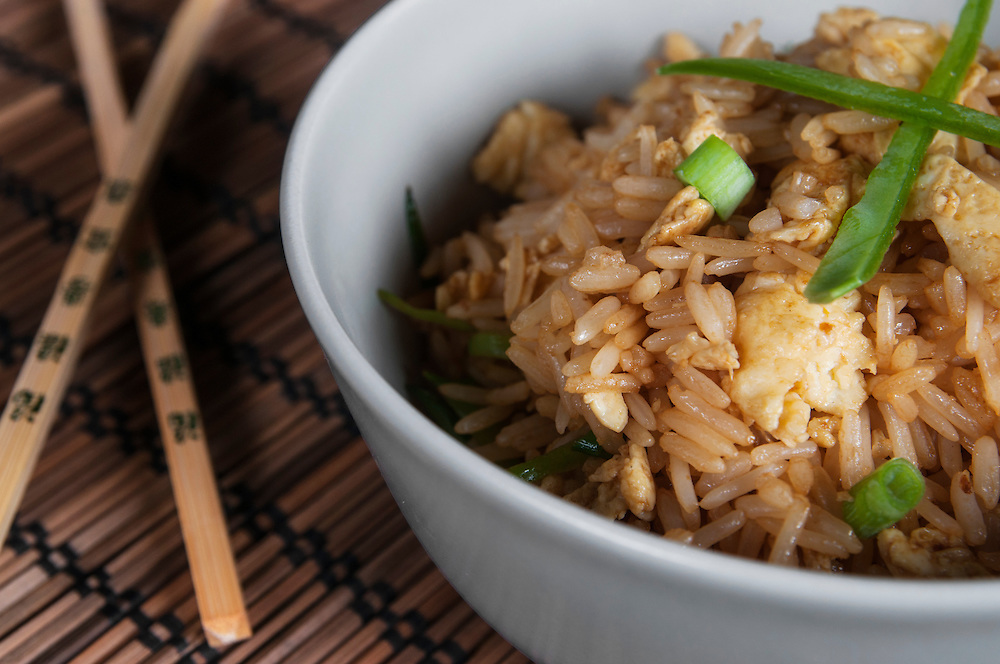 Egg fried rice with peas and spring onions.