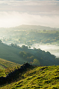 Sheen Hill and mist in the Upper Dove Valley, captured from High Wheeldon. An atmospheric landscape scene on the Derbyshire-Staffordshire border in the Peak District. England, UK.