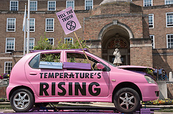 © Licensed to London News Pictures. 16/07/2019; Bristol, UK. Extinction Rebellion Summer Uprising 2019. A pink car in front of Bristol City City Hall at the Youth XR gathering on College Green. Extinction Rebellion are holding a five-day 'occupation' of Bristol, by occupying Bristol Bridge in the city centre and traffic has to be diverted and carrying out other events. As part of a country-wide rebellion called Summer Uprising, followers will be holding protests in five cities across the UK including Bristol on the theme of water and rising sea levels, which is the group's focus for the South West. The campaign wants the Government to change its recently-set target for zero carbon emissions from 2050 to 2025.<br /> In Bristol Extinction Rebellion plan a week-long occupation of Bristol Bridge in the city centre from Monday and organisers anticipate more than 1,000 people will take part in the action. On Tuesday, they will occupy College Green in front of the city's council house before protesting outside the Ministry of Defence in Stoke Gifford on Friday Photo credit: Simon Chapman/LNP.