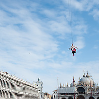 A Venetian girl performs as 'Colombina' during the Volo dell'Angelo, as she flies down from San Marco Tower to the square during the official opening of Venice Carnival San Marco is one of the six sestieri of Venice, lying in the heart of the city.