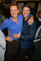 Left to right, BRUNO TONIOLI and JASON GARDNER at a party to celebrate the publication of Honestly Healthy Cleanse by Natasha Corrett held at Tredwell's Restaurant, 4a Upper St.Martin's Lane, London on 14th January 2015.