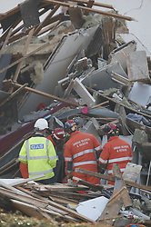 © Licensed to London News Pictures. 27/12/2018. Andover, UK. Emergency workers are seen amongst the ruins of a house in Andover, Hampshire where a mans body has been pulled from wreckage, following an explosion in the property. Residents have been evacuated form the area following a blast in the early hours of this morning. Photo credit: Peter Macdiarmid/LNP