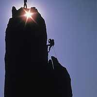 Rock Climbers rappel off of Eichorn's Pinnacle on Cathedral Peak in Yosemite National Park, California.