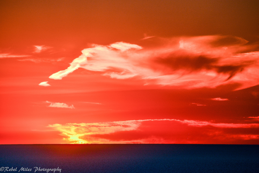 Orange Sunset With The Dark Blue Waters Of Lake Michigan As A Contrast