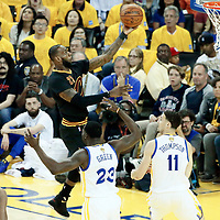 04 June 2017: Cleveland Cavaliers forward LeBron James (23) goes for the layup past Golden State Warriors forward Kevin Durant (35) Golden State Warriors forward Draymond Green (23) and Golden State Warriors guard Klay Thompson (11) during the Golden State Warriors 132-113 victory over the Cleveland Cavaliers, in game 2 of the 2017 NBA Finals, at the Oracle Arena, Oakland, California, USA.