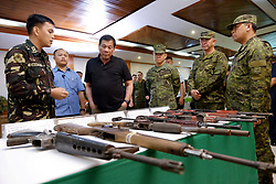 April 2, 2017 - Manila, Philippines - Philippine President Rodrigo Duterte examines firearms seized from the New Peoples Army during a visit to the 4th Infantry Division Headquarters at Camp Evangelista April 2, 2017 in Manila, Philippines. Standing with Duterte are Armed Forces of the Philippines Chief of Staff Lieutenant General Eduardo Ano  (Credit Image: © Kiwi Bulaclac/Planet Pix via ZUMA Wire)