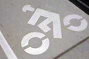 bicycle lane sign on cement