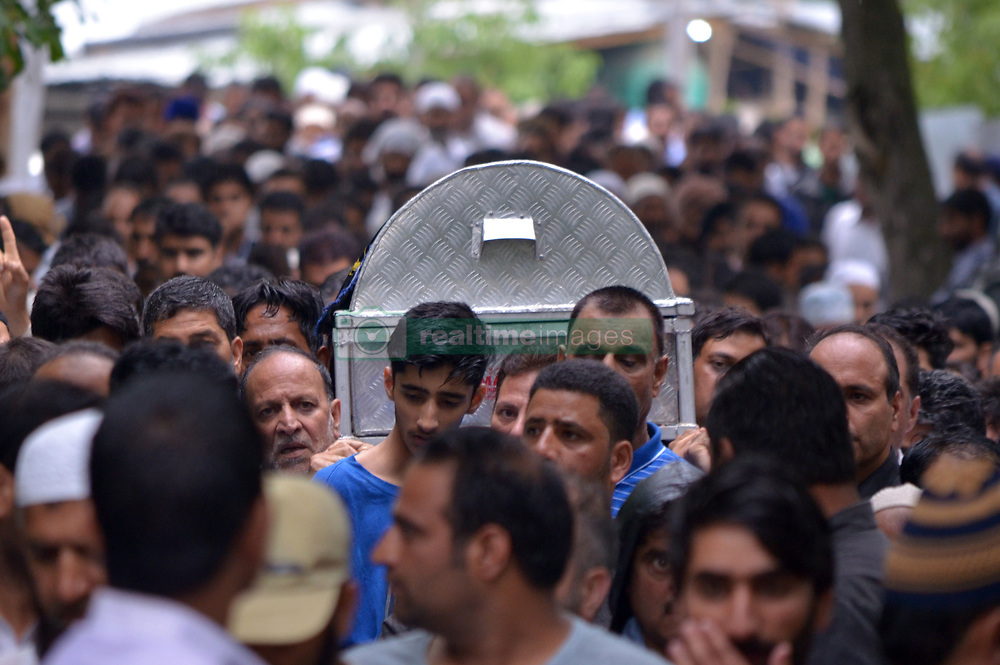June 15, 2018 - Baramullah, Jammu and Kashmir, India - People carry the coffin of Shujaat Bukhari, slain Editor-in-Chief of the Kashmir Based Local English daily newspaper Rising Kashmir, during his funeral at Kreeri area of Baramullah District of Indian Administered Kashmir on 15 June 2018. Bukhari was killed after unknown gunmen shot on his vehicle killing Bukhari and two of his Body Guards. However, no Kashmir militant group has claimed the responsibility and has urged United Nations to probe the Killing of the Senior Editor internationally. (Credit Image: © Muzamil Mattoo/Pacific Press via ZUMA Wire)