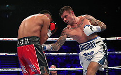 Roberto Garcia (left) and Martin Murray during the The WBC Silver Middleweight Championship at The O2, London.