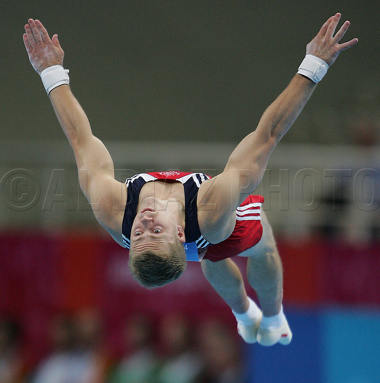 8/16/04 --Al Diaz/Miami Herald/KRT--Athens, Greece--Men's Team Final in Gymnastics Artistic at the Olympic Indoor Hall during the Athens 2004 Olympic Games. USA's Guard Young hit's a 9.700 on the floor exercise.