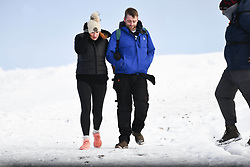 © Licensed to London News Pictures. 04/12/2020. <br /> A couple walk up Penyfan, in the Brecon Beacons, the highest point in southern Wales and England, which has seen it's first snowfall of the year. Photo credit: Robert Melen/LNP