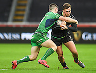 Ospreys' Ashley Beck is tackled by Connacht's John Cooney.<br /> <br /> Guinness Pro12 rugby match, Ospreys v Connacht rugby at the Liberty Stadium in Swansea, South Wales on Saturday 7th January 2017.<br /> pic by Craig Thomas, Andrew Orchard sports photography.