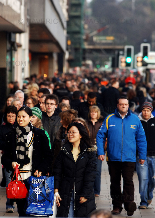 The last Sunday shopping day before Christmas. Christmas shoppers on Princes Street in Edinburgh. ..Pic shows shoppers on Princes Street in Edinburgh.