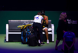 October 26, 2018 - Kallang, SINGAPORE - Naomi Osaka of Japan receives medical attention at the 2018 WTA Finals tennis tournament (Credit Image: © AFP7 via ZUMA Wire)