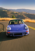 Image of a custom 1974 Porsche 911 RS coupe on a road in Washington state, Pacific Northwest, model and property released by Randy Wells