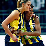 Fenerbahce's Angel MCoughtry (R) and İvana Matovic (L) celebrate victory during their Turkish Basketball woman league derby match Fenerbahce between Galatasaray at Ulker Sports Arena in Istanbul, Turkey, wednesday, December 26, 2012. Photo by Aykut AKICI/TURKPIX
