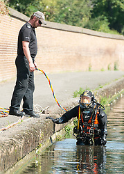 © Licensed to London News Pictures. 08/09/2014. Isleworth, UK Police divers search for missing school girl Alice Gross today 8th Septemebr 2014. Alice Gross of Hanwell, west London, was last seen by her family at about 13:00 BST on 28 August. CCTV footage shows her walking along the Grand Union Canal tow path near the Holiday Inn at Brentford Lock between 13:30 BST and 17:30 BST.. Photo credit : Stephen Simpson/LNP