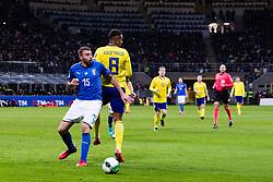 November 13, 2017 - Milano, ITALIEN - 171113 Italiens Andrea Barzagli i kamp om bollen med Sveriges Isaac Kiese Thelin under fotbollsmatchen i VM-kvalets play-off mellan Italien och Sverige den 13 november 2017 i Milano. (Credit Image: © Andreas L Eriksson/Bildbyran via ZUMA Wire)