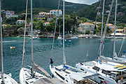 Boats and yachts in the bay at Kioni, Ithaca, Greece. Ithaca, Ithaki or Ithaka is a Greek island located in the Ionian Sea to the west of continental Greece. Ithacas main island has an area of 96 square kilometres. It is the second-smallest of seven main Ionian Islands.