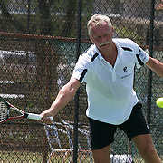 Henk Korteling, The Netherlands, in action against Armistead Neely, USA, in the Von Cramm Cup match against The Netherlands, during the 2009 ITF Super-Seniors World Team and Individual Championships at Perth, Western Australia, between 2-15th November, 2009..