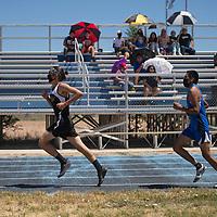 Devin Roper, left, of Navajo Prep overtakes AJ Lastayano of Zuni in the boys 3200 meter run Friday in Zuni.