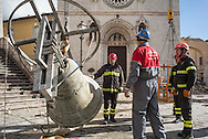 Firemen removing a bell ftom the Civic Tower in the town of Norcia. The tower is very unstable and firemen are removing bells to keep take off some weight from the structures dameged by the 6.1 earthquake that hit the region on October 30th 2016.