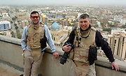 Reporter Mike Francis and photographer Randy L. Rasmussen against a view of downtown Baghdad. Francis and Rasmussen are embedded with the 2nd Battalion, 162nd Infantry of the Oregon Army National Guard. Photo by Randy L. Rasmussen/The Oregonian