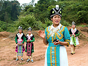 White Hmong men and women playing the ball throwing game of 'pov pob' at Ban Hauywai Hmong New Year festival, Phongsaly province, Lao PDR. 'Pov pob' is a formalised courting ritual where unmarried men and women face each other in a line and toss cloth balls to one another using only one hand. The Hmong celebration of New Year is based on the lunar calendar. This important time is an opportunity to honour ancestors and spirits through offerings and rituals and to partake in games, sports, feasts, shows, bullfights and courtship. The Hmong are the third largest ethnic group in Laos. One of the most ethnically diverse countries in Southeast Asia, Laos has 49 officially recognised ethnic groups although there are many more self-identified and sub groups. These groups are distinguished by their own customs, beliefs and rituals.
