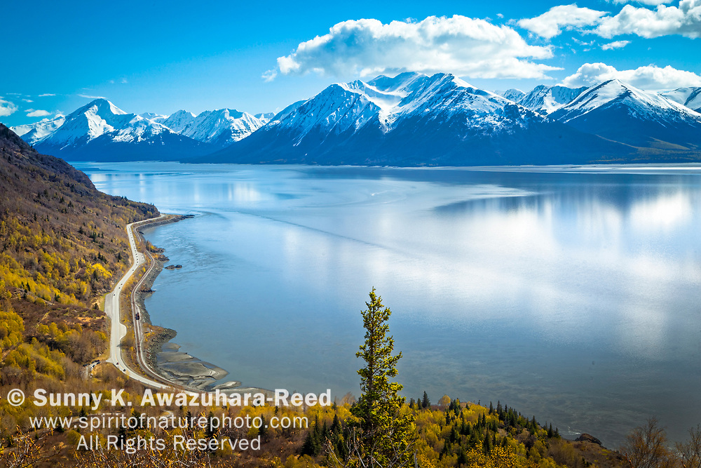 Overlook of snow capped Kenai Mountains and Turnagain Arm of Cook Inlet along Seward Highway. Chugach State Park, Southcentral Alaksa, Spring.