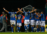 Photo: Glyn Thomas.<br />Italy v Ukraine. Quarter Finals, FIFA World Cup 2006. 30/06/2006.<br /> Italy's Luca Toni is mobbed by teammates after scoring his side's second goal.