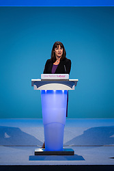 © Licensed to London News Pictures . 23/09/2013 . Brighton , UK . RACHEL REEVES , Shadow Chief Secretary to the Treasury , addresses the conference during the Work and Business Stability and Prosperity session this afternoon (Monday 23rd September 2013) on Work and Business Stability and Prosperity. Day 2 of the Labour Party 's annual conference in Brighton . Photo credit : Joel Goodman/LNP