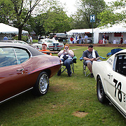 Car owners between vehicles at the Greenwich Concours d'Elegance Festival of Speed and Style featuring great classic vintage cars. Roger Sherman Baldwin Park, Greenwich, Connecticut, USA.  2nd June 2012. Photo Tim Clayton