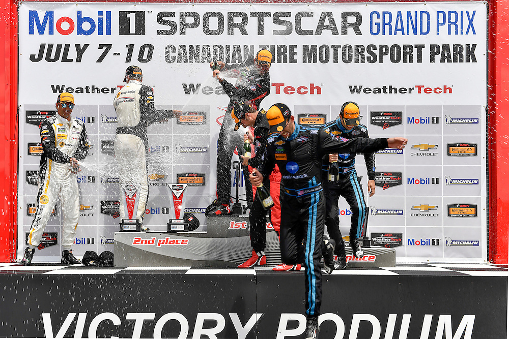 7-10 July 2016, Bowmanville, Ontario Canada<br /> Prototype winners podium 31, Chevrolet, Corvette DP, P, Eric Curran, Dane Cameron, 10, Chevrolet, Corvette DP, P, Ricky Taylor, Jordan Taylor, 5, Chevrolet, Corvette DP, P, Joao Barbosa, Christian Fittipaldi, celebrate with champagne <br /> ©2016, Scott R LePage <br /> LAT Photo USA