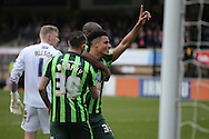Lyle Taylor of AFC Wimbledon celebrates © celebrates after scoring his teams 2nd goal from a penalty to make it 1-2 with Tom Elliott of AFC Wimbledon and Rhys Murphy of AFC Wimbledon. Skybet football league two match, Wycombe Wanderers  v AFC Wimbledon at Adams Park  in High Wycombe, Buckinghamshire on Saturday 2nd April 2016.<br /> pic by John Patrick Fletcher, Andrew Orchard sports photography.