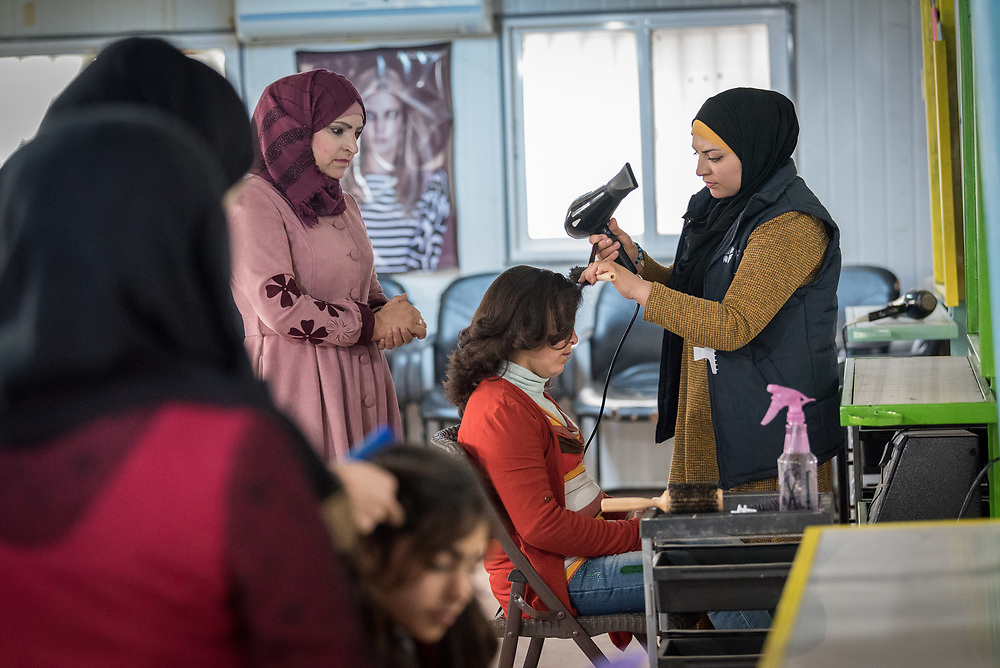 20 February 2020, Za'atari Camp, Jordan: Trainer Rehab Heraki (right) leads hairdressing class in the Peace Oasis, a Lutheran World Federation space in the Za'atari Camp where Syrian refugees are offered a variety of activities on psychosocial support, including counselling, life skills trainings and other activities.