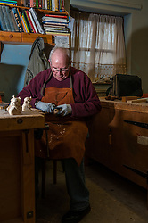 Senior male wood carving at an over 50's club run by the local council. Essex *Model Released*