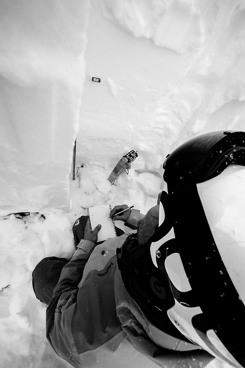 Tanner Flanagan study the snowpack within Grand Teton National Park.