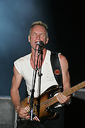 The Police featuring Sting (vocals, bass) Andy Summers (guitar, backing vocals), and Stewart Copeland (drums, percussion, backing vocals) performs during the third day of the 2007 Bonnaroo Music & Arts Festival on June 16, 2006 in Manchester, Tennessee. The four-day music festival features a variety of musical acts, arts and comedians..Photo by Bryan Rinnert..Sting (vocals, bass) Andy Summers (guitar, backing vocals), and Stewart Copeland (drums, percussion, backing vocals).