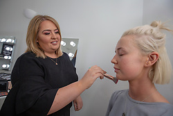 Stacey Whittaker, a mum-of-two who has set up her own beauty salon at Pouts & Pinups, Kirkcaldy. Pic with hairdresser Abbie Johnstone, the model for her make-up photos. For London Money Desk.