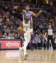 October 21, 2017 - Denver, Colorado, U.S - Nuggets WILL BARTON, center below, goes in for a lay-up with Kings GARRETT TEMPLE, top, behind him during the 1st. Half at the Pepsi Center Saturday night. The Nuggets beat the Kings 96-79. (Credit Image: © Hector Acevedo via ZUMA Wire)
