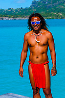 Polynesian man with tattoos, Four Seasons Resort Bora Bora, French Polynesia.