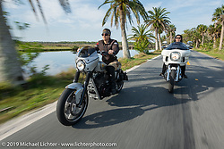 Andrea Labarbara (L) riding her Roland Sands RSD custom with Vanessa Klock on her Harley on a ride through Tomoka State Park during Daytona Beach Bike Week, FL. USA. Friday, March 15, 2019. Photography ©2019 Michael Lichter.