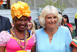 The Duchess of Cornwall poses with a well-wisher during a guided tour of Old Havana, in Havana, Cuba.