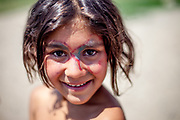 Girl with a painted face at the Roma settlement in Moldava nad Bodvou. From about 800 inhabitants of the segregated settlement 'Budulovska Street' (2014) are roughly 392 children up to the age of 16 years.