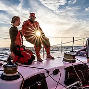 Leg 02, Lisbon to Cape Town, day 13, on board MAPFRE, Sophie Ciszek, Xabi Fernandez and Blair Tuke on deck during the sunrise. Photo by Ugo Fonolla/Volvo Ocean Race. 17 November, 2017