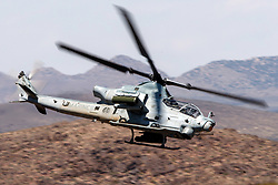 United States Marines Corps Bell AH-1Z Viper (SN 168529) flies low level on the Jedi Transition through Star Wars Canyon / Rainbow Canyon, Death Valley National Park, Panamint Springs, California, United States of America