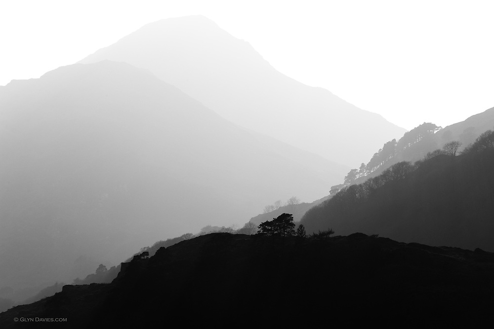 Heavy mist surrounds Yr Aran, one of the smaller peaks of Yr Wyddfa (Snowdon), as seen from the Nant Gwynant Valley, Northern Snowdonia.