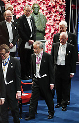 """Nobelpreisverleihung 2016 in der Konzerthalle in Stockholm / 101216 ***Japanese scientist Yoshinori Ohsumi (C on front) arrives at a concert hall in Stockholm to attend the Nobel Prize Award Ceremony on Dec. 10, 2016. Ohsumi was awarded the Nobel prize in physiology or medicine for elucidating """"autophagy,"""" an intracellular process that degrades and recycles proteins."""
